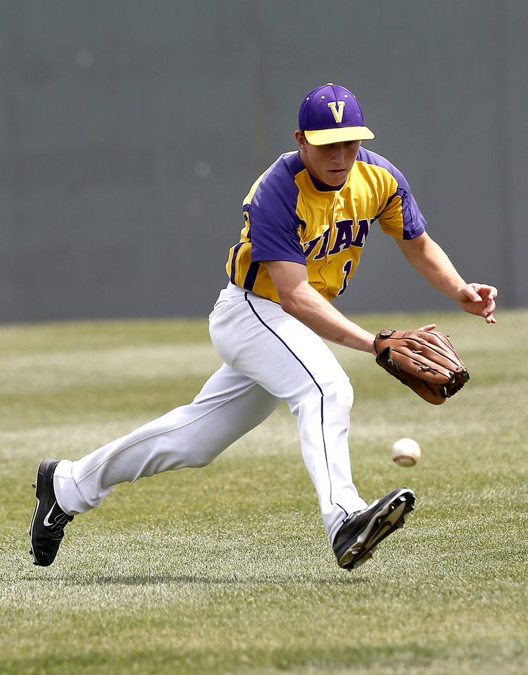 Photo - Vain's J.T. Frazier tries to field a grounder during the class 3A baseball game between Verdigris and Vian at Edmond Memorial High School in Edmond, Okla., Friday, May 16, 2014. Photo by Sarah Phipps, The Oklahoman