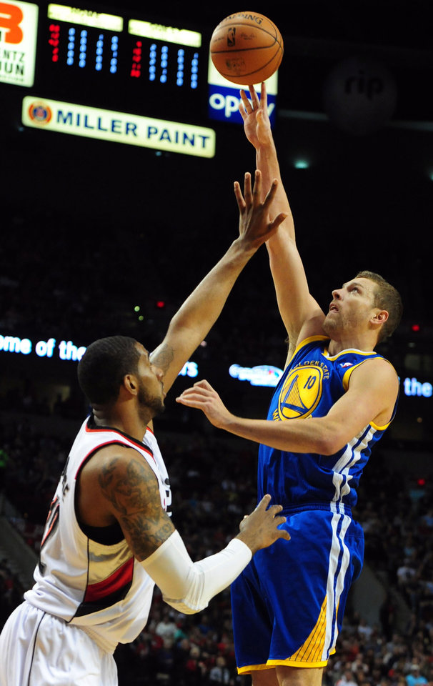 Photo - Golden State Warriors forward David Lee (10) shoots the ball over Portland Trail Blazers forward LaMarcus Aldridge (12) during the first half of an NBA basketball game in Portland, Ore., Sunday, April 13, 2014. (AP Photo/Steve Dykes)