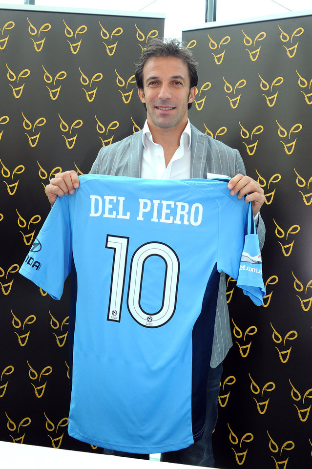 Photo -   Former Italy and Juventus forward Alessandro Del Piero poses with Sydney FC jersey at the Lingotto Palace in Turin, Italy,Wednesday, Sept. 5,2012. Del Piero is joining Sydney FC in a deal that will make him the highest-profile player in the A-League. The two-year deal is reportedly worth US$2 million per season, which will make Del Piero the highest paid athlete in Australia's four football codes, including rugby league, rugby union and Australian Rules. The 37-year-old Del Piero reportedly turned down offers from English Premier League clubs Liverpool and Southampton. He was also linked with moves to the Middle East, China, Argentina, the United States and Switzerland. (AP Photo/Massimo Pinca)