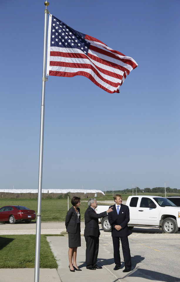 Photo - King Willem-Alexander, right, of the Netherlands, is greeted by Iowa Gov. Terry Branstad, center, and Iowa Lt. Gov. Kim Reynolds, left, while arriving at the opening of one of the nation's first commercial size cellulosic ethanol plants, Wednesday, Sept. 3, 2014, in Emmetsburg, Iowa. Project Liberty is a $250 million plant that will make 25 million gallons of ethanol a year from corn cobs, stalks, leaves and other plant residue. (AP Photo/Charlie Neibergall)