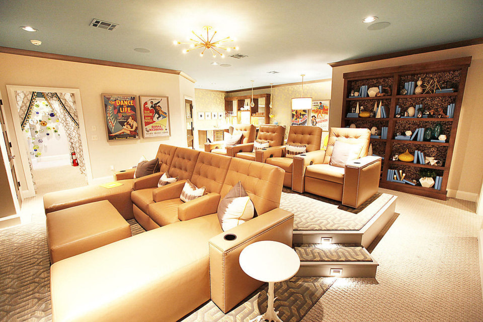 Photo - Comfort defines the eight-seat theater room at 1501 NW 158.  PAUL HELLSTERN - The Oklahoman