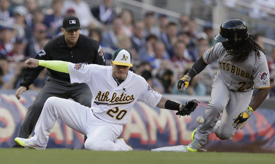 Photo - National League outfielder Andrew McCutchen, of the Pittsburgh Pirates, steals third base as American League Josh Donaldson, of the Oakland Athletics, tries to make the tag during the first inning of the MLB All-Star baseball game, Tuesday, July 15, 2014, in Minneapolis. (AP Photo/Jeff Roberson)