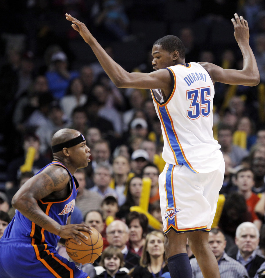 Photo - Oklahoma City's Kevin Durant (35) dfends Al Harrington (7) of New York during the NBA basketball game between the Oklahoma City Thunder and the New York Knicks at the Ford Center in Oklahoma City, January 11, 2010. Photo by Nate Billings, The Oklahoman