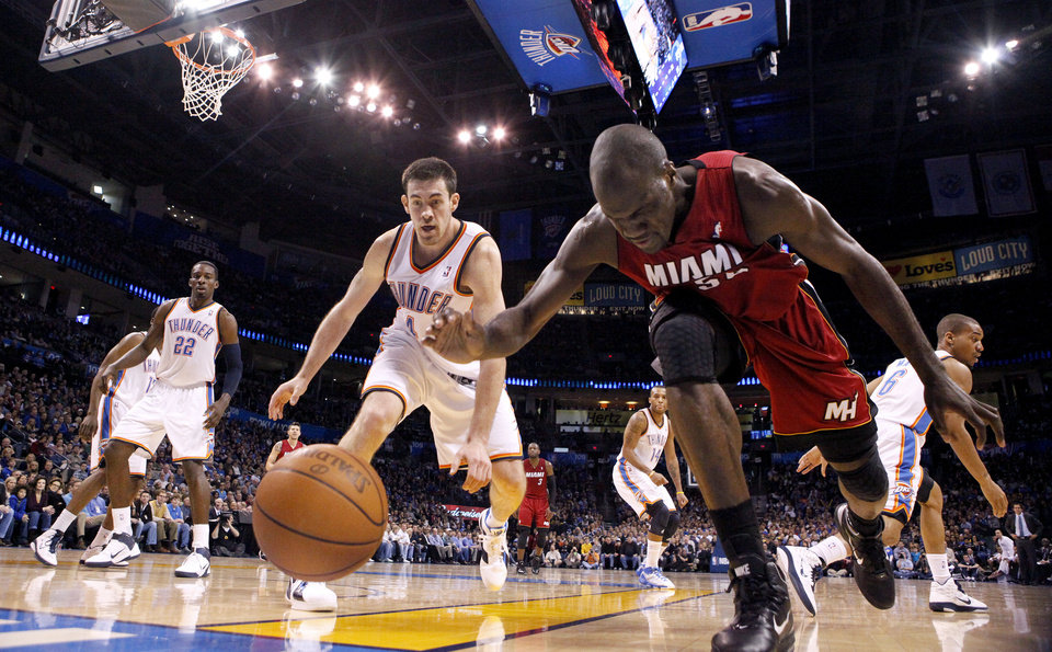 Photo - Miami's Joel Anthony (50) and Oklahoma City's Nick Collison (4) scramble for a loose ball during the NBA basketball game between Oklahoma City and Miami at the OKC Arena in Oklahoma City, Thursday, Jan. 30, 2011. Photo by Sarah Phipps, The Oklahoman