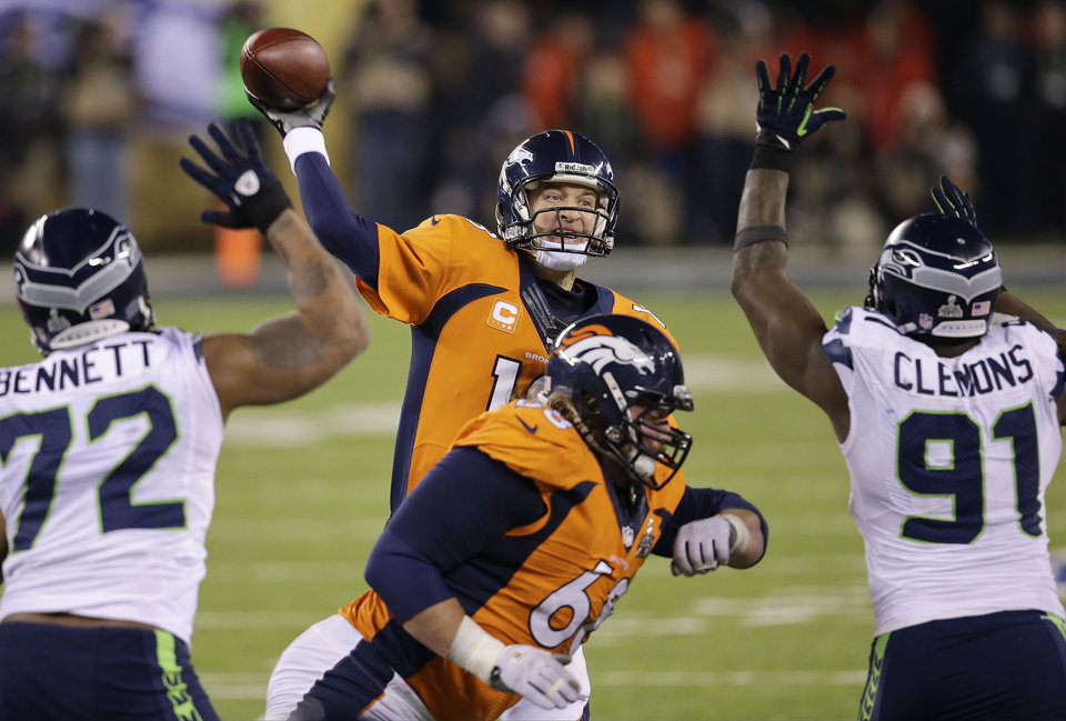 Photo - Denver Broncos' Peyton Manning throws against the Seattle Seahawks during the second half of the NFL Super Bowl XLVIII football game Sunday, Feb. 2, 2014, in East Rutherford, N.J. (AP Photo/Chris O'Meara)