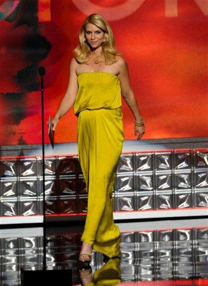 Claire Danes presents an award onstage at the 64th Primetime Emmy Awards at the Nokia Theatre on Sunday, Sept. 23, 2012, in Los Angeles. (Photo by John Shearer/Invision/AP)