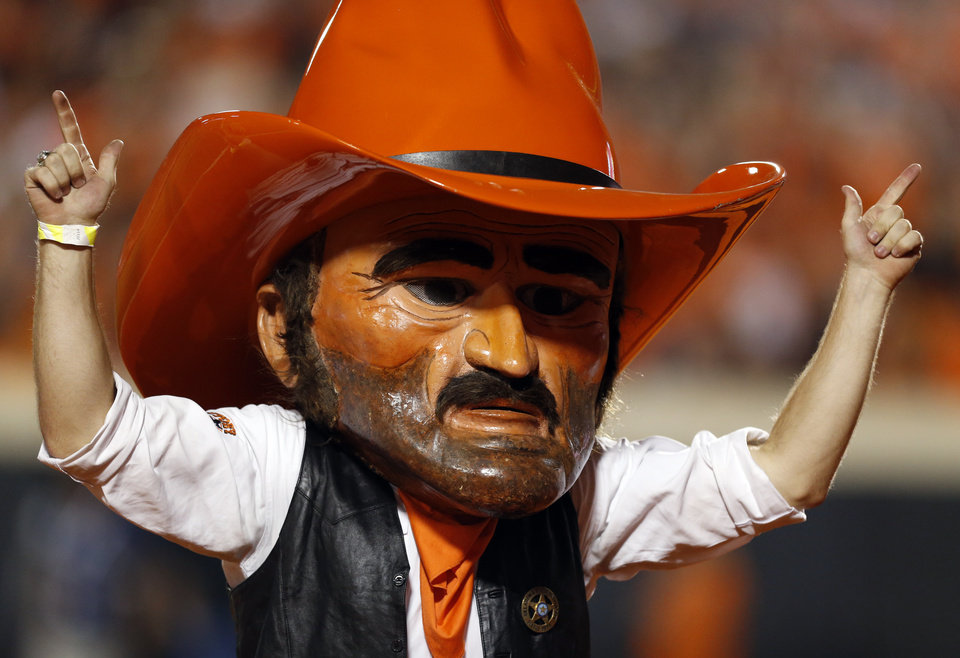 Photo - OSU mascot Pistol Pete during a college football game between the Oklahoma State Cowboys (OSU) and the Texas Tech Red Raiders at Boone Pickens Stadium in Stillwater, Okla., Thursday, Sept. 25, 2014. OSU won, 45-35. Photo by Nate Billings, The Oklahoman