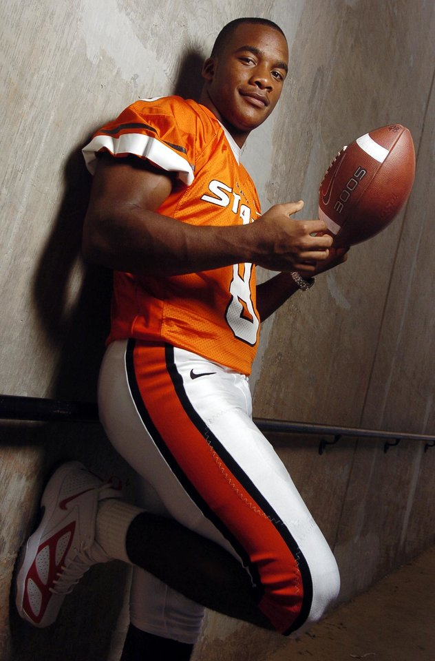 Photo - Stillwater, Okla. - August 10, 2004. Quarterback Donovan Woods (8) poses for a photograph in the tunnel that leads to Lewis Field for The Oklahoman's football preview section during Oklahoma State University (OSU) Cowboys college football media and fan appreciation day. Staff photo by Nate Billings.