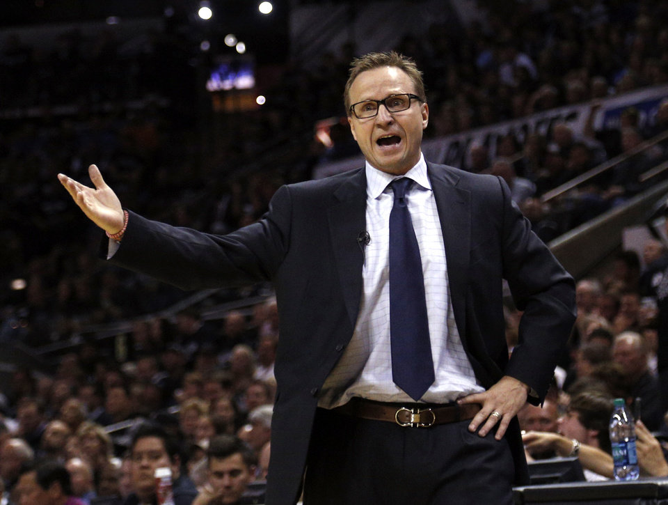 Photo - Oklahoma City head coach Scott Brooks reacts to a call during Game 1 of the Western Conference Finals in the NBA playoffs between the Oklahoma City Thunder and the San Antonio Spurs at the AT&T Center in San Antonio, Monday, May 19, 2014. Photo by Sarah Phipps, The Oklahoman
