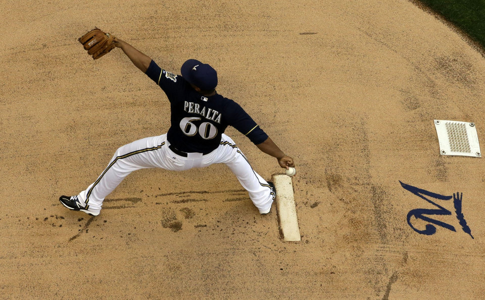 Milwaukee Brewers starting pitcher Wily Peralta throws during the first inning of a baseball game against the Atlanta Braves, Friday, June 21, 2013, in Milwaukee. (AP Photo/Morry Gash)