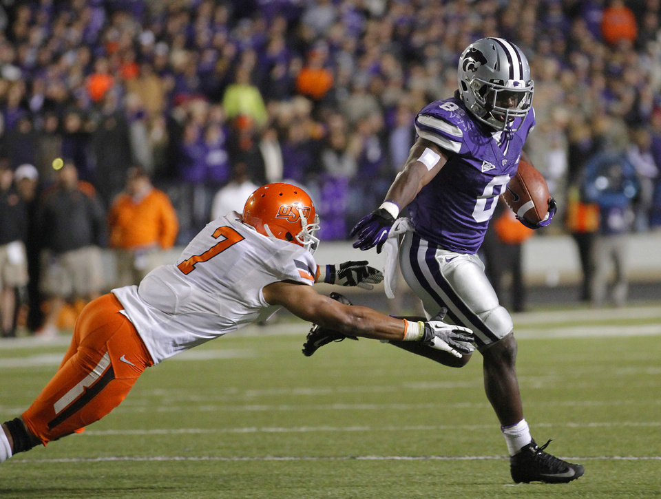 Photo - Kansas State's Angelo Pease (8) runs past Oklahoma State's Shamiel Gary (7) during the college football game between the Oklahoma State University Cowboys (OSU) and the Kansas State University Wildcats (KSU) at Bill Snyder Family Football Stadium on Saturday, Nov. 1, 2012, in Manhattan, Kan. Photo by Chris Landsberger, The Oklahoman