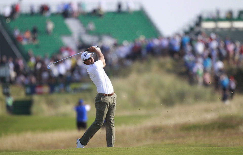 Photo - Adam Scott of Australia plays a shot on the 14th fairway during the first day of the British Open Golf championship at the Royal Liverpool golf club, Hoylake, England, Thursday July 17, 2014. (AP Photo/Peter Morrison)