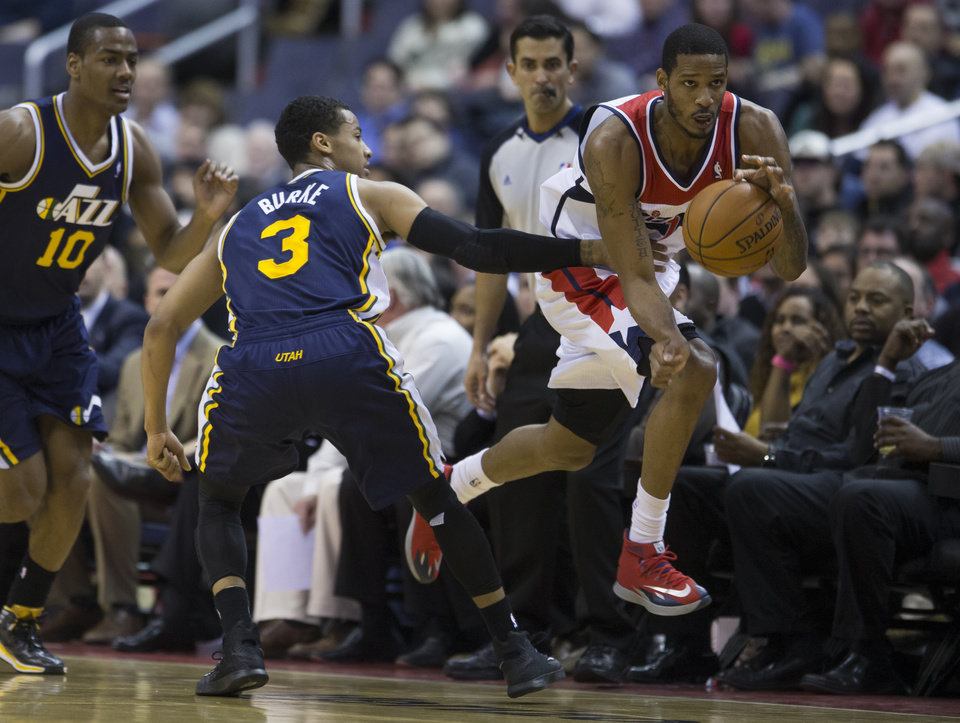 Photo - Utah Jazz point guard Alec Burks (10) and guard Trey Burke (3) watch as Washington Wizards small forward Trevor Ariza steals the ball during the first half of an NBA basketball game on Wednesday, March 5, 2014, in Washington. (AP Photo/ Evan Vucci)