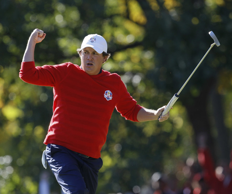 Photo - USA's Jason Dufner reacts after making a birdie putt on the 13th hole during a singles match at the Ryder Cup PGA golf tournament Sunday, Sept. 30, 2012, at the Medinah Country Club in Medinah, Ill. (AP Photo/Charles Rex Arbogast)  ORG XMIT: PGA170