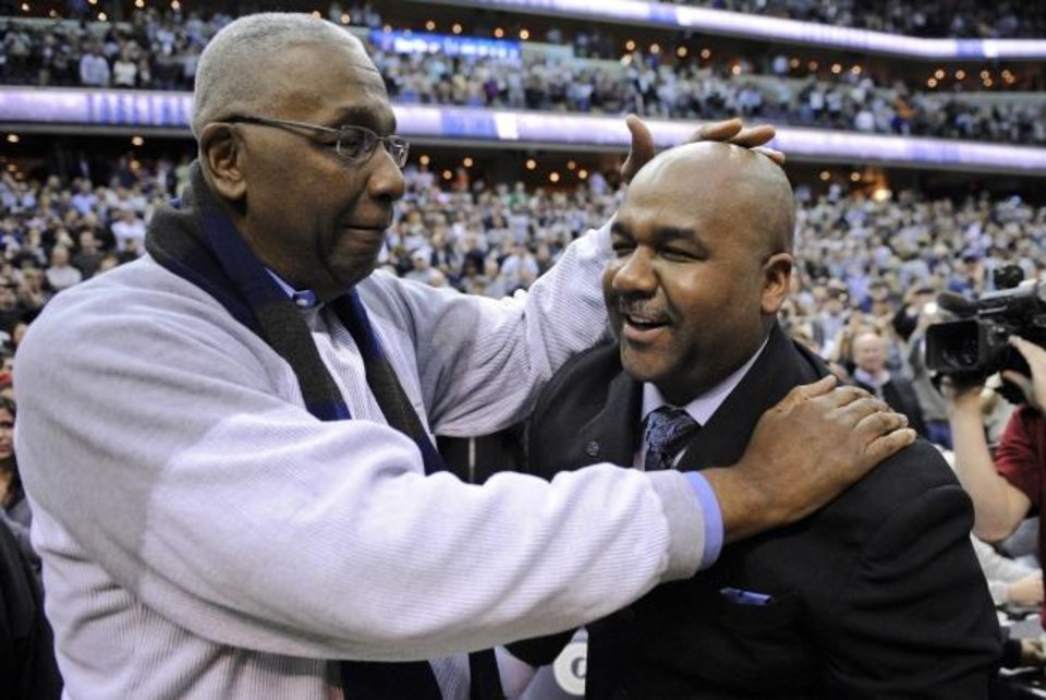 Photo -  John Thompson Jr., left, congratulates his son, then-Georgetown head coach John Thompson III, after a 61-39 win over Syracuse in 2013. The younger Thompson doesn't believe his father would be pleased with the amount of Black coaches in college basketball. [AP Photo/Nick Wass]