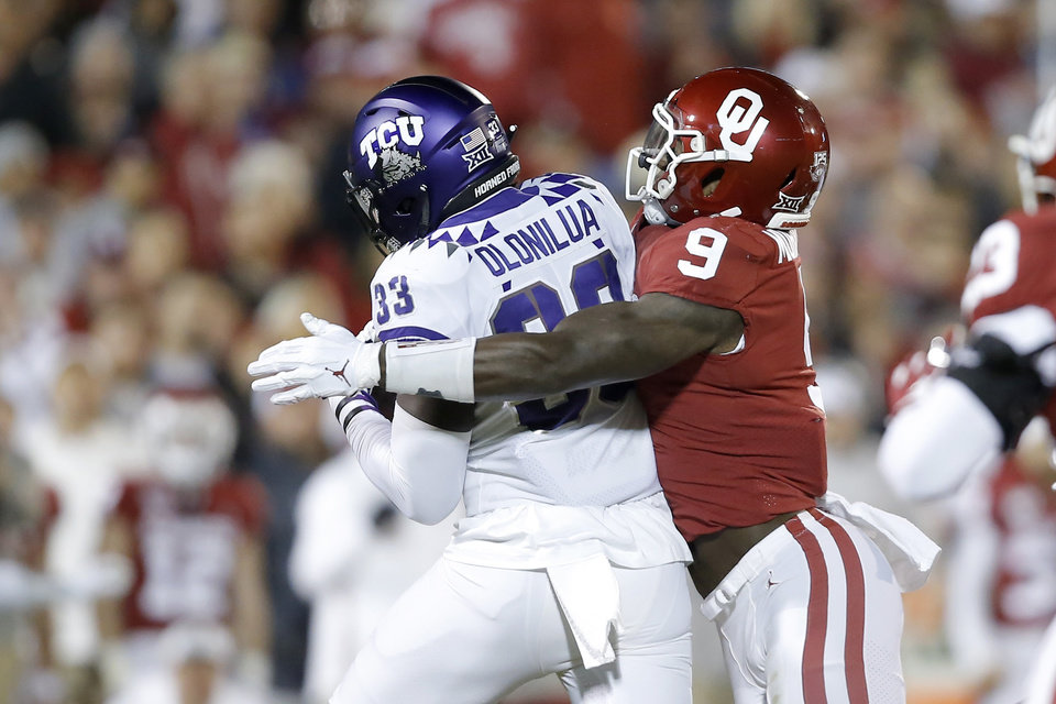 Photo - Oklahoma's Kenneth Murray (9) brings down TCU's Sewo Olonilua (33) during an NCAA football game between the University of Oklahoma Sooners (OU) and the TCU Horned Frogs at Gaylord Family-Oklahoma Memorial Stadium in Norman, Okla., Saturday, Nov. 23, 2019. [Bryan Terry/The Oklahoman]