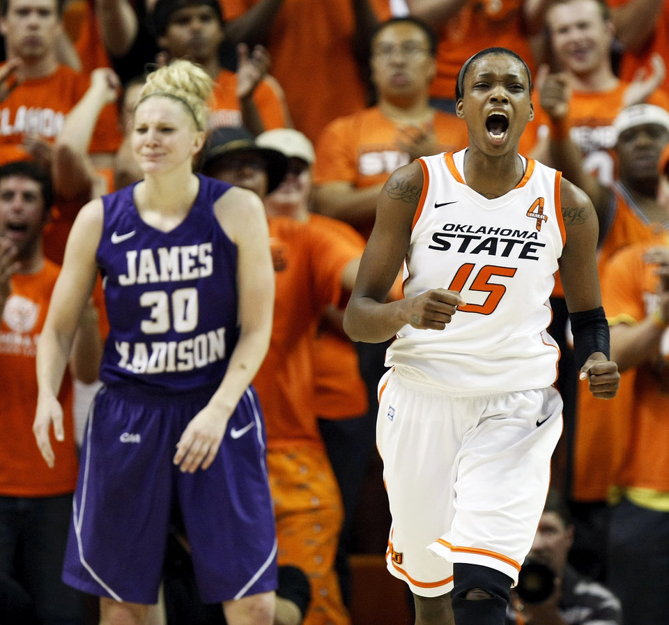 Photo - OSU's Toni Young (15) reacts after making a basket while being fouled by James Madison's Nikki Newman (30) during the Women's NIT championship college basketball game between Oklahoma State University and James Madison at Gallagher-Iba Arena in Stillwater, Okla., Saturday, March 31, 2012. Photo by Nate Billings, The Oklahoman