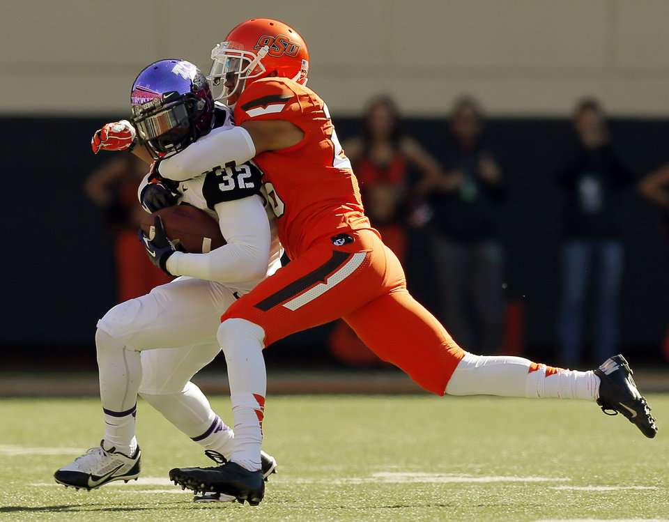 Oklahoma State\'s Tyler Patmon (26) tackles TCU\'s Waymon James (32) after a reception during a college football game between the Oklahoma State University Cowboys (OSU) and the Texas Christian University Horned Frogs (TCU) at Boone Pickens Stadium in Stillwater, Okla., Saturday, Oct. 19, 2013. Photo by Nate Billings, The Oklahoman