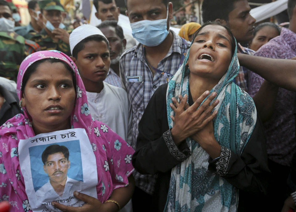 Photo - Bangladeshi relatives of missing workers react as they wait at the site of a building that collapsed Wednesday in Savar, near Dhaka, Bangladesh, Friday, April 26, 2013. By Friday, the death toll reached at least 270 people as rescuers continued to search for injured and missing, after a huge section of an eight-story building that housed several garment factories splintered into a pile of concrete.(AP Photo/Kevin Frayer)