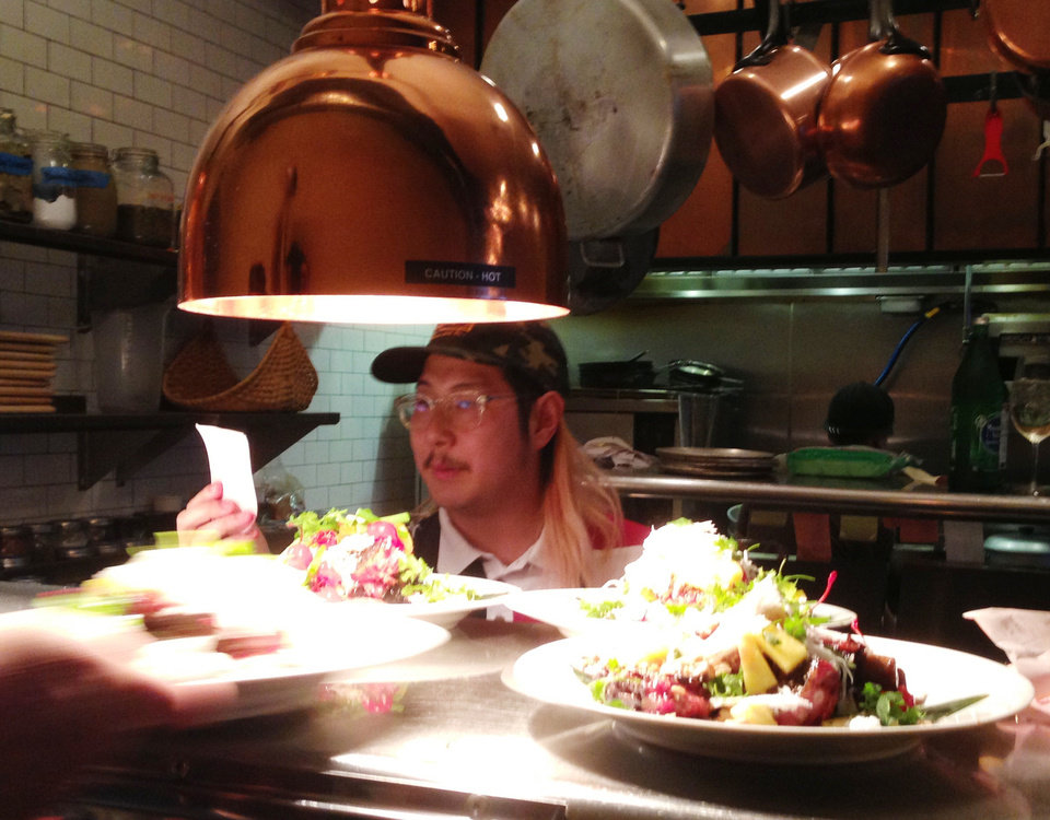 Chef Danny Bowien checks a ticket at Ludivine on Monday. <strong>DAVE CATHEY - THE OKLAHOMAN</strong>