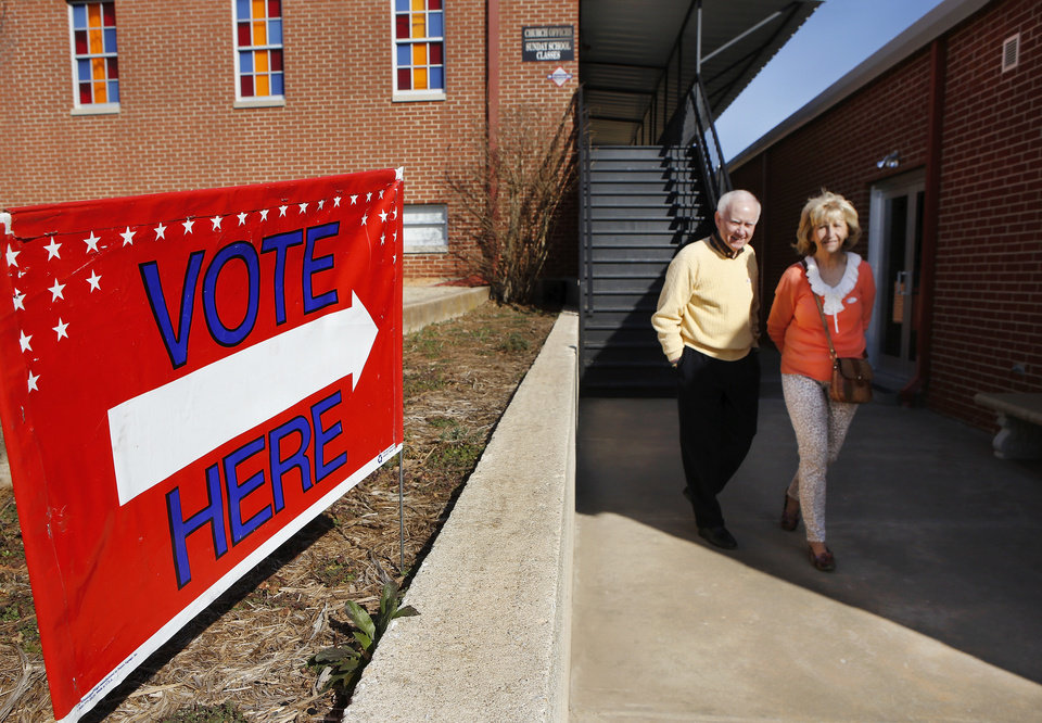 Photo - Bill and Berney Porter walking out of Oakdale Baptist Church at Hefner and Sooner Road, after voting in Precinct 108 for the Oklahoma City Council Ward 7 election on Tuesday, March 5, 2013. Photo by Jim Beckel, The Oklahoman
