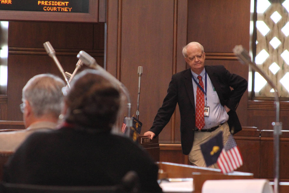 Photo - Senate President Peter Courtney, D-Salem, stands on the Senate floor on Thursday, March 6, 2014 at the state Capitol in Salem, Ore. The Oregon Legislature is pushing to adjourn as soon as Friday. (AP Photo/Chad Garland)