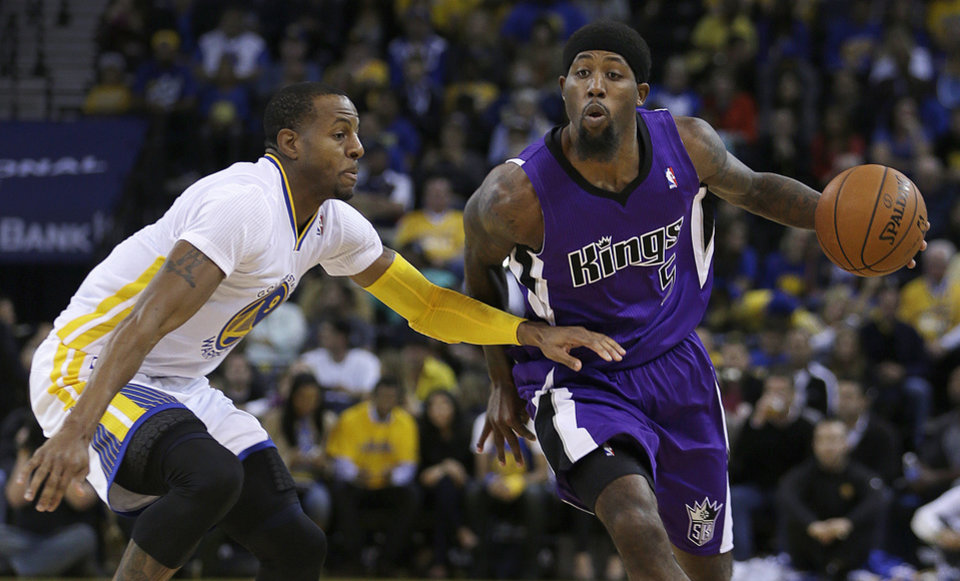 Photo - Sacramento Kings' John Salmons, right, drives the ball past Golden State Warriors' Andre Iguodala during the first half of an NBA basketball game on Saturday, Nov. 2, 2013, in Oakland, Calif. (AP Photo/Ben Margot)