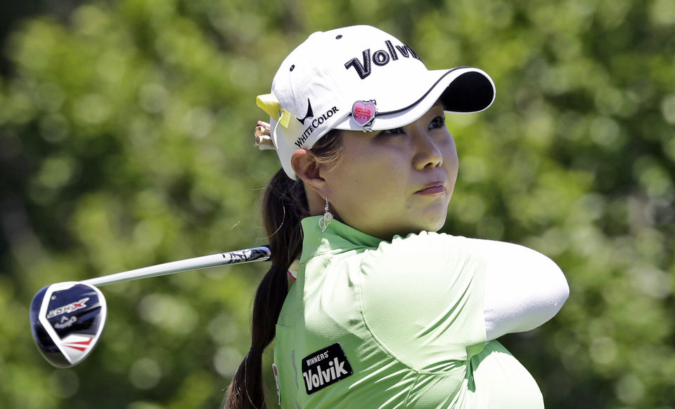 Photo - Meena Lee, of South Korea, watches her tee shot on the second hole during the third round of the North Texas LPGA Shootout golf tournament at the Las Colinas Country Club in Irving, Texas, Saturday, May 3, 2014. (AP Photo/LM Otero)