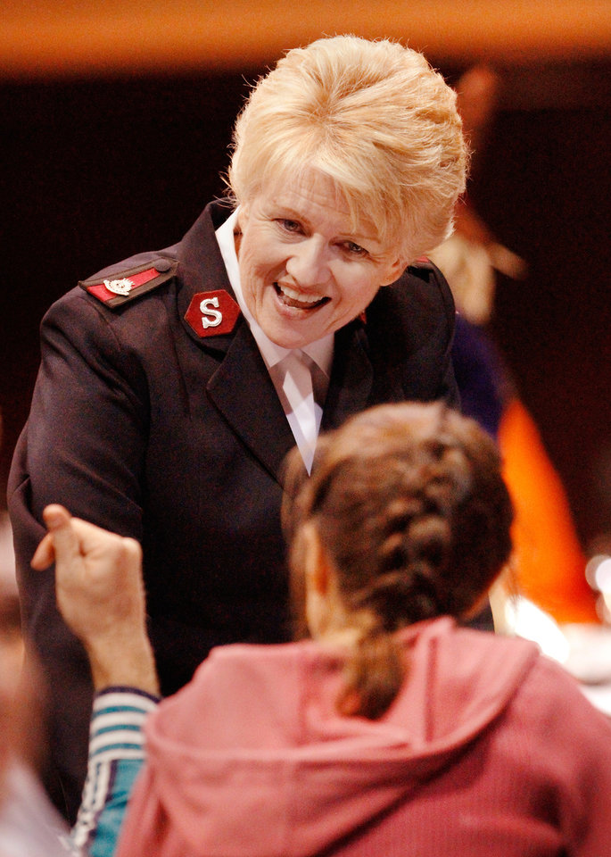 Photo - The Salvation Army's Maj. Francina Proctor mingles throughout the room, visiting with Thanksgiving guests. Proctor is co-ordinator for Women's Ministries.  Salvation Army spokesperson Heidi Brandes said more than 1,000 guests were served a hot meal at the  Thanksgiving brunch by volunteers in the Coca-Cola Bricktown Events Center .Thursday morning,  Nov. 24, 2011.  Diners were served eggs, sausage, hash brown potatoes, biscuits and gravy, juice and coffee. Donuts, donated by Krispy Kreme, were also offered to guests. Photo by Jim Beckel, The Oklahoman   Photo by Jim Beckel, The Oklahoman