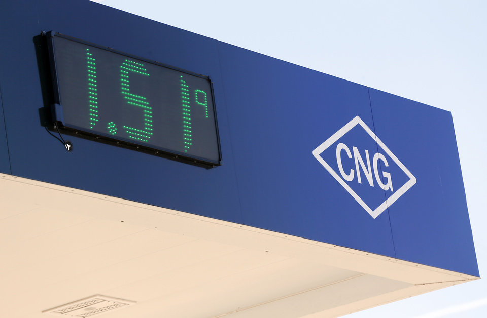 Photo -  A sign shows the price of CNG for the public at the new CNG fueling station Wednesday at Oklahoma City's Solid Waste Facility. Photo by Nate Billings, The Oklahoman   NATE BILLINGS -