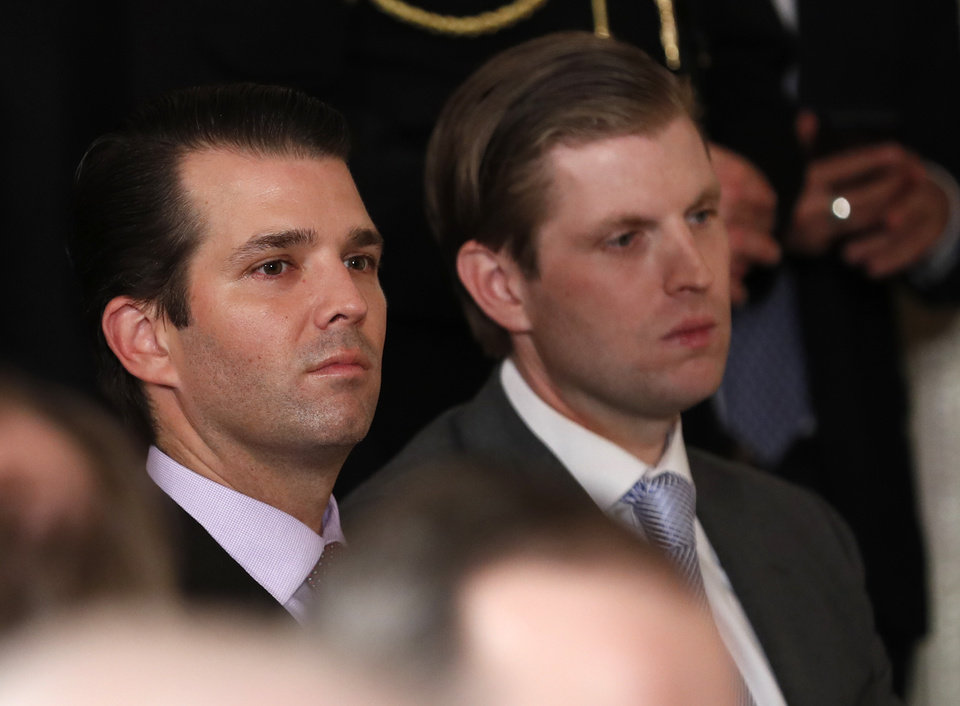 Photo - Donald Trump Jr., left, and Eric Trump, son's of President Donald Trump wait in the East Room of the White House in Washington, Tuesday, Jan. 31, 2017, for the announcement of the nominee for the Supreme Court. (AP Photo/Carolyn Kaster)