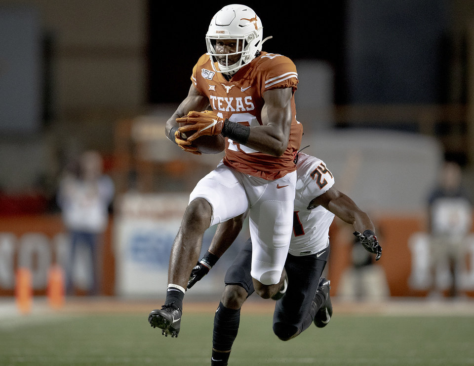 Photo - Texas wide receiver Brennan Eagles (13) runs for a touchdown after catching a pass against Oklahoma State during an NCAA college football game Saturday, Sept. 21, 2019, in Austin, Texas. (Nick Wagner/Austin American-Statesman via AP)