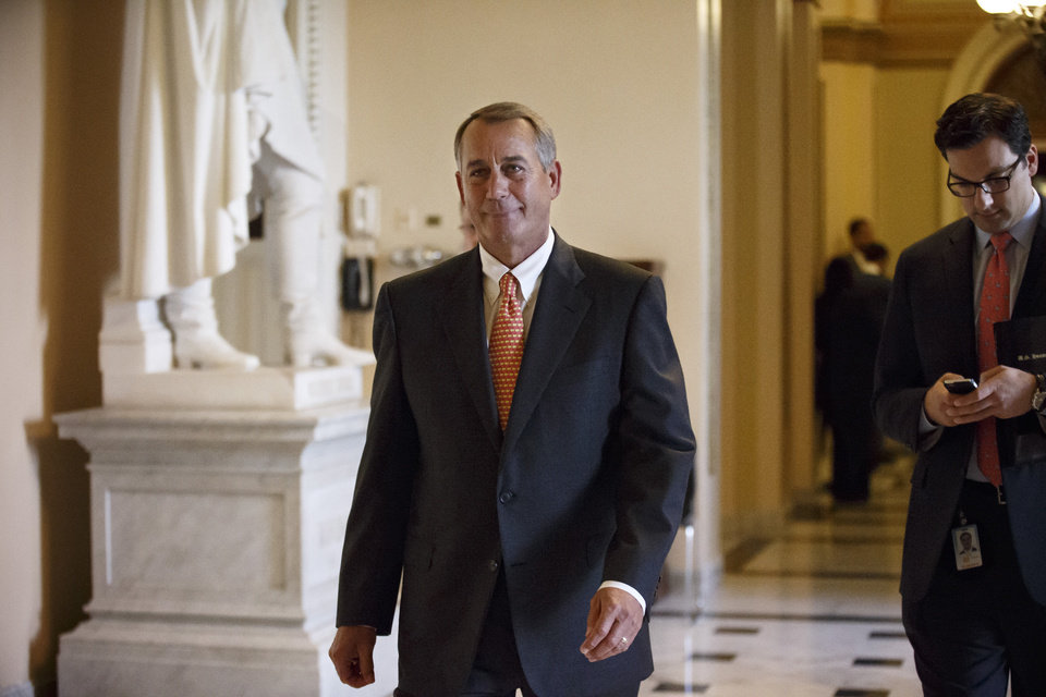 House Speaker John Boehner of Ohio leaves the House chamber on Capitol Hill in Washington, Wednesday, Jan. 15, 2014, after the final vote on a massive $1.1 trillion spending bill. The measure sailed through the House with no suspense and little dissent — fueled additionally by lawmakers' desire to avoid an election-year replay of last fall's widely unpopular 16-day federal shutdown. (AP Photo/J. Scott Applewhite)