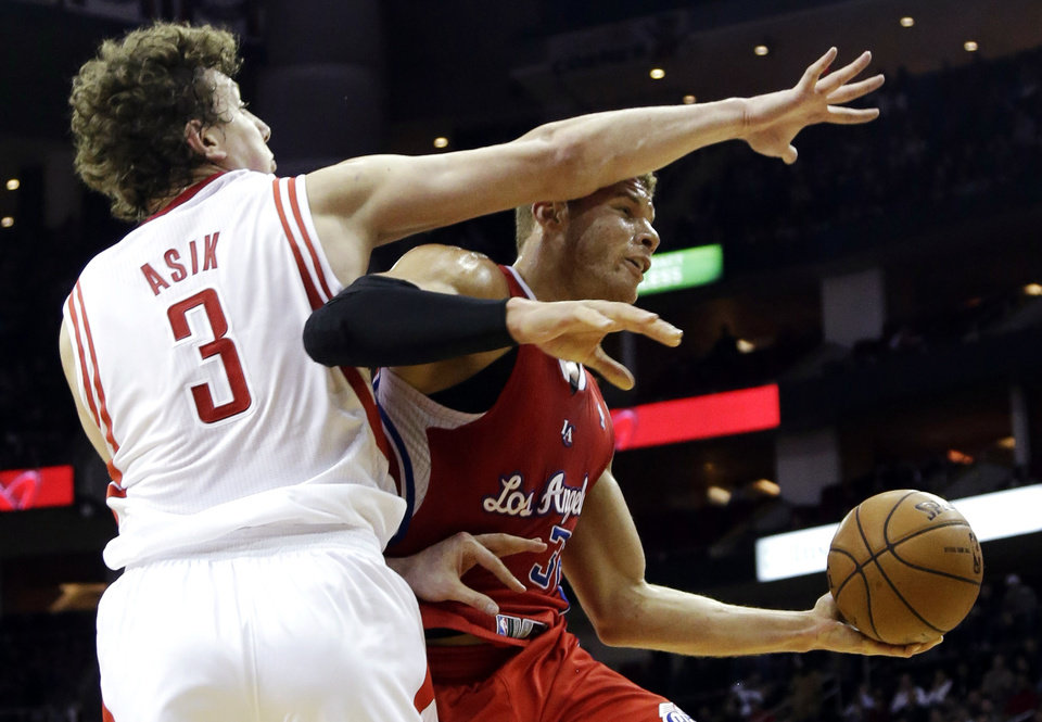 Los Angeles Clippers' Blake Griffin (32) is fouled by Houston Rockets' Omer Asik (3) during the first half of an NBA basketball game, Tuesday, Jan. 15, 2013, in Houston. (AP Photo/David J. Phillip)