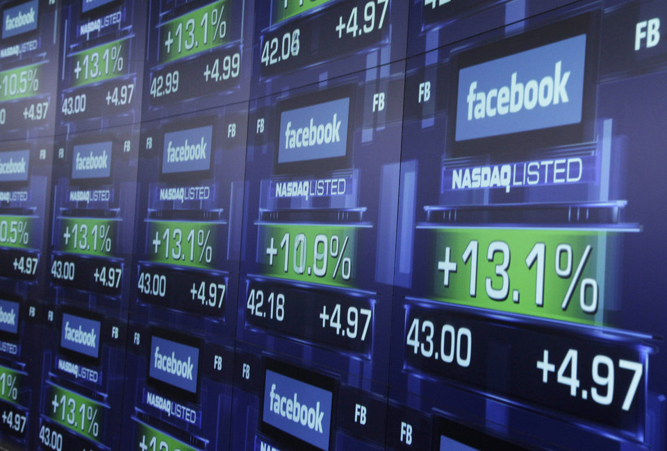Photo -   FILE - In this Friday, May 18, 2012 file photo, electronic screens show the price of Facebook shares after they began trading in New York. Facebook Inc.'s stock took a hit Monday, Sept. 24, 2012, after an article in Barron's said it is