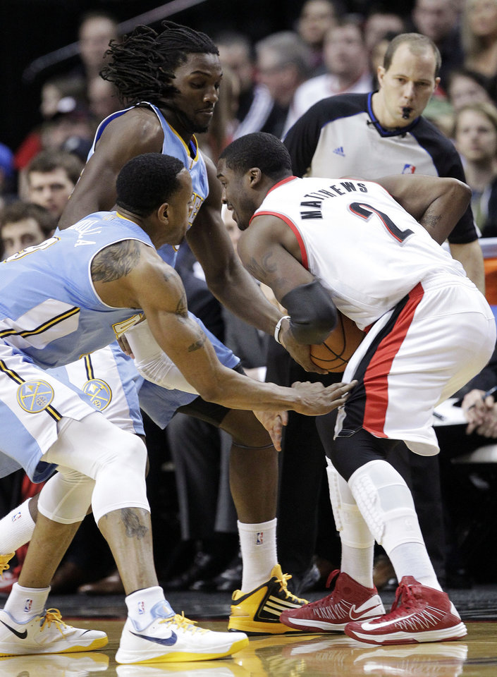 Photo - Portland Trail Blazers guard Wesley Matthews (2) is double-teamed by Denver Nuggets' Andre Iguodala, left, and Kenneth Faried during the first quarter of an NBA basketball game in Portland, Ore., Wednesday, Feb. 27, 2013. (AP Photo/Don Ryan)