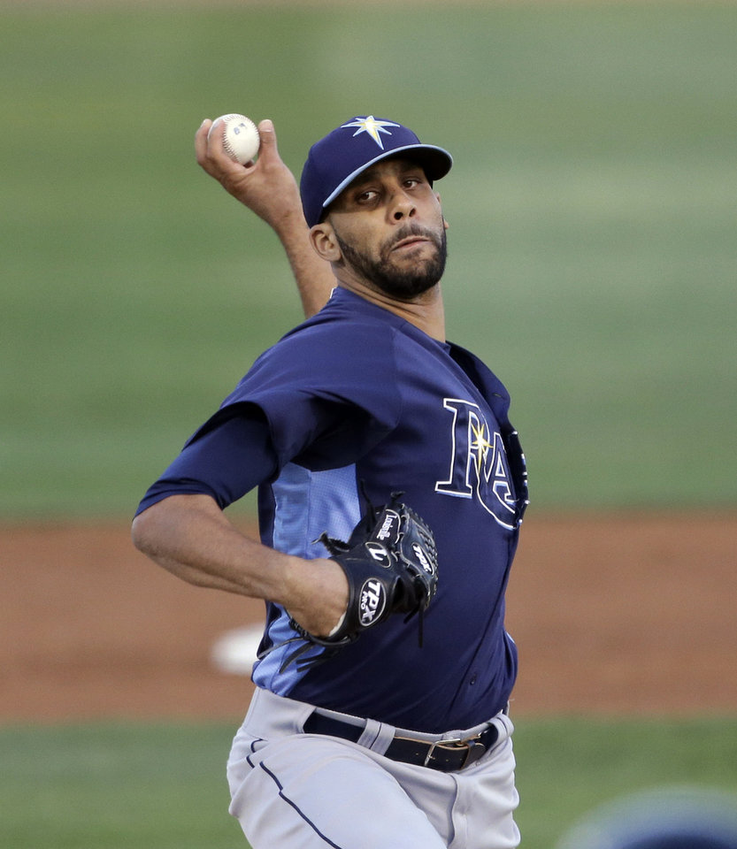 Tampa Bay Rays starting pitcher David Price throws during the first inning of an exhibition spring training baseball game against the Baltimore Orioles, Thursday, March 28, 2013, in Sarasota, Fla. (AP Photo/Carlos Osorio)