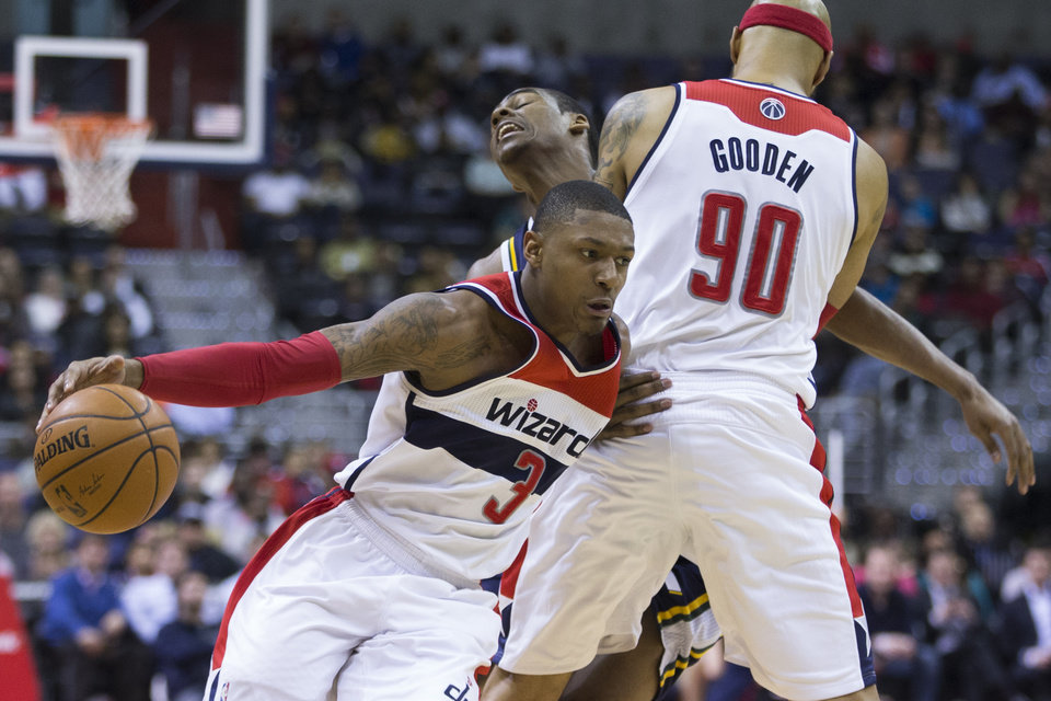 Photo - Washington Wizards power forward Drew Gooden (90) sets a pick on Utah Jazz point guard Alec Burks (10) for teammate Washington Wizards shooting guard Bradley Beal (3) during the first half of an NBA basketball game on Wednesday, March 5, 2014, in Washington. (AP Photo/ Evan Vucci)