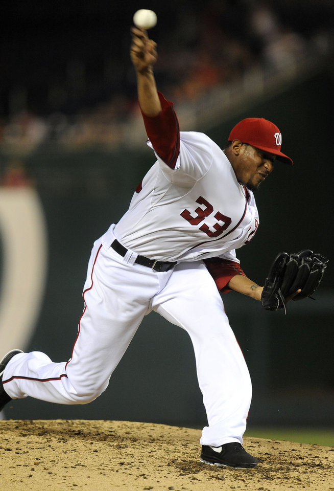 Photo -   Washington Nationals' Edwin Jackson delivers a pitch in the third inning during their baseball game against the Chicago Cubs at Nationals Park, Tuesday, Sept. 4, 2012, in Washington. (AP Photo/Richard Lipski)