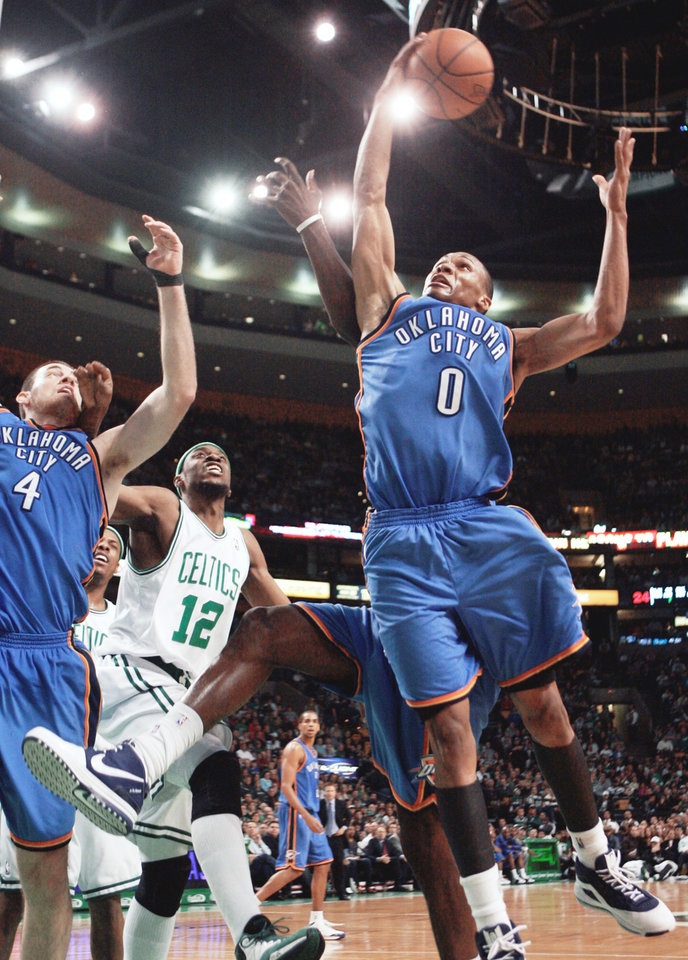 Photo - Thunder guard Russell Westbrook, right, scored 23 points in his team's 103-84 loss at Boston on Sunday. Ap photo