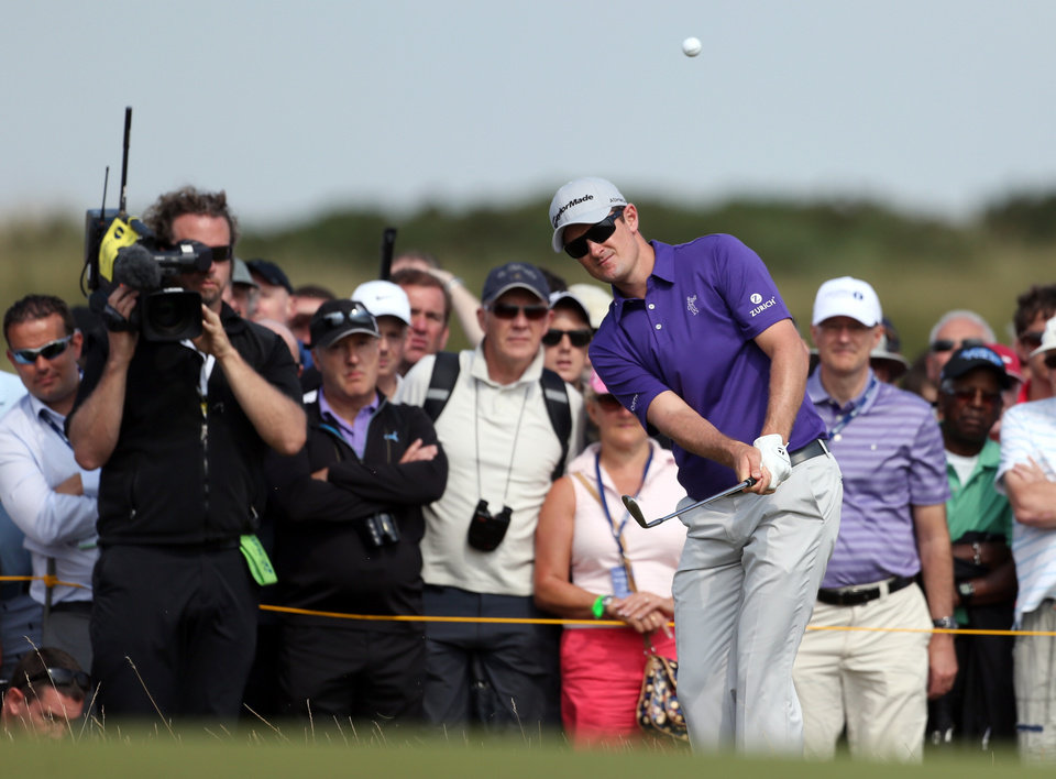 Photo - Justin Rose of England chips onto the 5th green during the second day of the British Open Golf championship at the Royal Liverpool golf club, Hoylake, England, Friday July 18, 2014. (AP Photo/Peter Morrison)