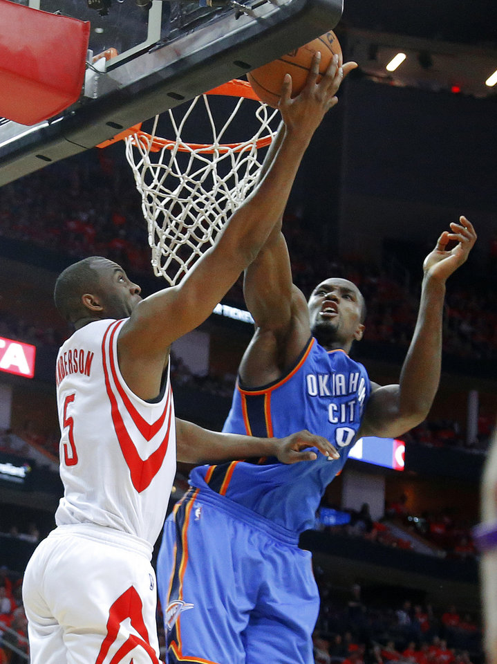 Photo - Oklahoma City's Serge Ibaka (9) blocks the shot of Houston's James Anderson (5) during Game 6 in the first round of the NBA playoffs between the Oklahoma City Thunder and the Houston Rockets at the Toyota Center in Houston, Texas, Friday, May 3, 2013. Oklahoma City won 103-94. Photo by Bryan Terry, The Oklahoman