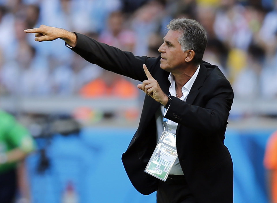 Photo - Iran's head coach Carlos Queiroz gives indications to his players from the touchline during the group F World Cup soccer match between Argentina and Iran at the Mineirao Stadium in Belo Horizonte, Brazil, Saturday, June 21, 2014. (AP Photo/Victor R. Caivano)