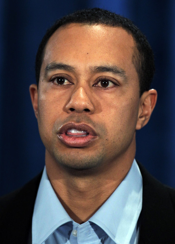 Photo - Tiger Woods makes a statement at the Sawgrass Players Club, Friday, Feb. 19, 2010, in Ponte Vedra Beach, Fla. (AP Photo/Joe Skipper, Pool) ORG XMIT: TWP110