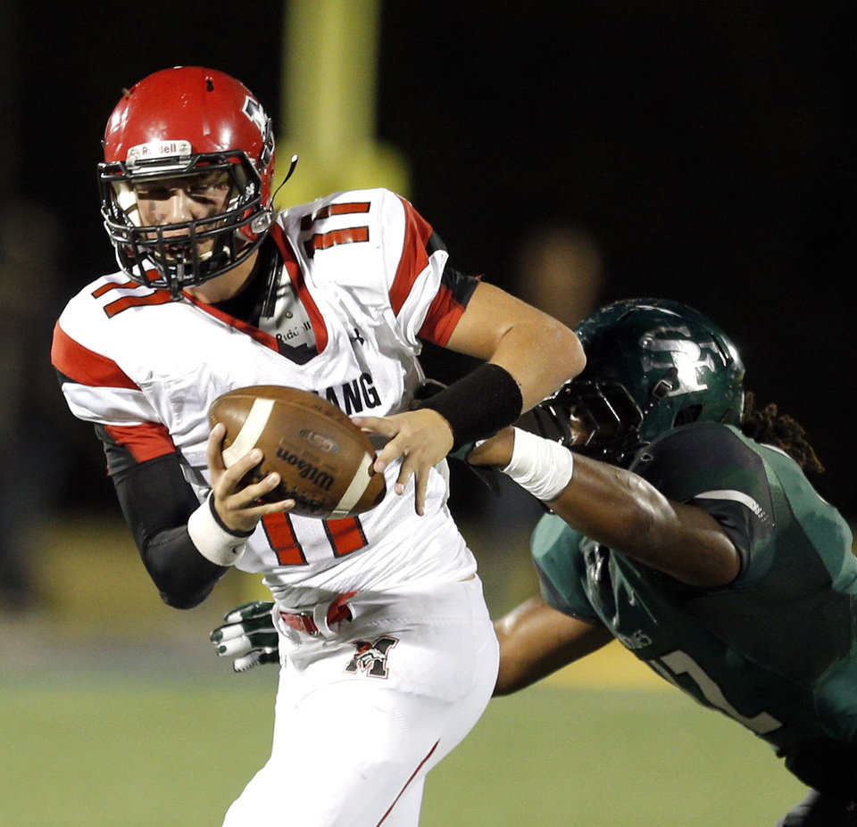 Photo -                    Mustang junior Chandler Garrett took over the starting job in the middle of last season.                                       Photo by Sarah Phipps, The Oklahoman Archives