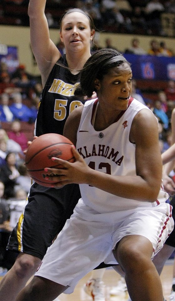 OU's Kaylon Williams (42) keeps the ball away from Missouri's Christine Flores (50) during the Big 12 tournament women's college basketball game between the University of Oklahoma Sooners and the University of Missouri Tigers at Municipal Auditorium in Kansas City, Mo., Thursday, March 8, 2012. OU won, 70-59. Photo by Nate Billings, The Oklahoman