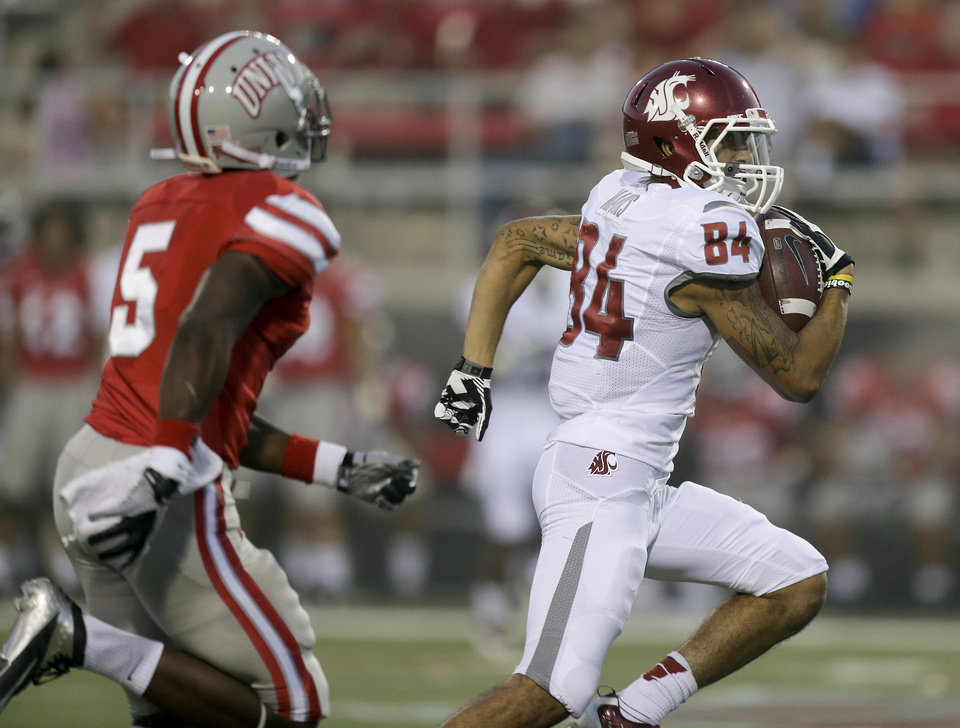 Photo -   Washington State wide receiver Gabe Marks (84) gets by UNLV defensive back Dre Crawford (5) on his way to a touchdown in the second quarter of an NCAA college football game, Friday, Sept. 14, 2012, in Las Vegas. (AP Photo/Julie Jacobson)
