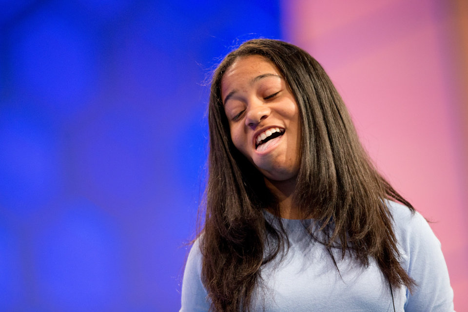 "Photo - Alexandra Harper, 14, of San Juan, Puerto Rico, reacts after correctly spelling ""triskelion"" during the preliminaries of the Scripps National Spelling Bee, Wednesday, May 27, 2015, at National Harbor in Oxon Hill, Md. (AP Photo/Andrew Harnik)"