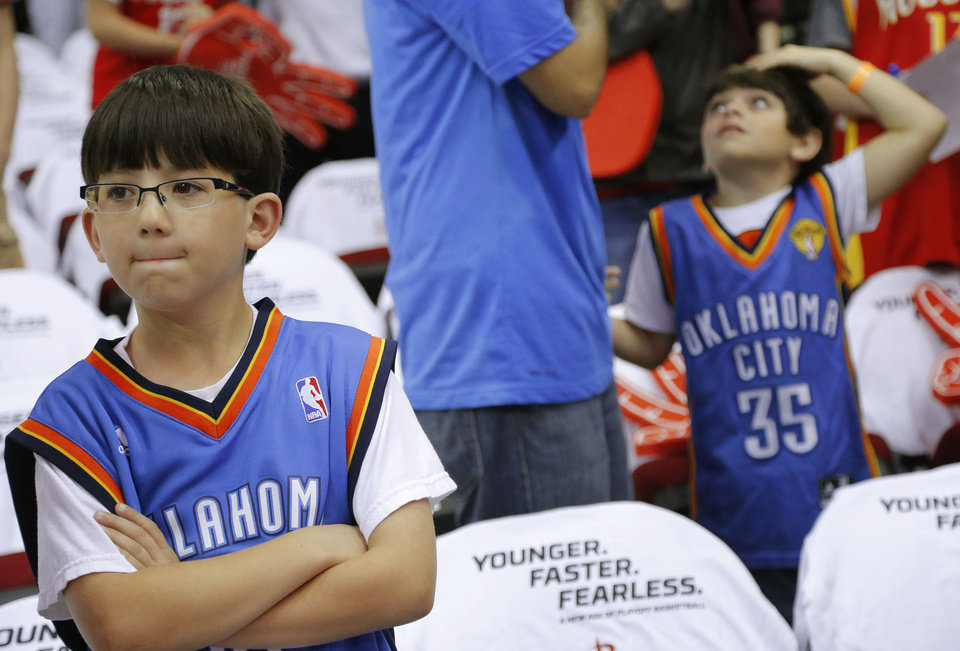 Photo - Mason Osborn, 9, of Lafayette La., waits for the start of Game 3 in the first round of the NBA playoffs between the Oklahoma City Thunder and the Houston Rockets at the Toyota Center in Houston, Texas, Sat., April 27, 2013. Photo by Bryan Terry, The Oklahoman