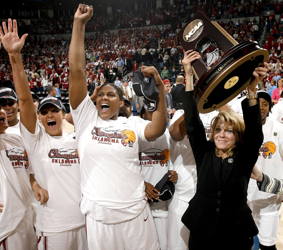 Photo - OU's Sherri Coale, right, Courtney Paris, and Jenny Vining after their win in the NCAA women's basketball regional  tournament finals between Oklahoma and Purdue at the Ford Center in Oklahoma City, Tuesday, March 31, 2009.  OU won, 74-68. Photo by Bryan Terry, The Oklahoman